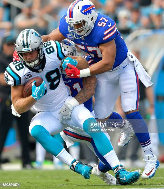 Greg Olsen of the Carolina Panthers makes a catch against Lorenzo Alexander of the Buffalo Bills during their game at Bank of America Stadium on...