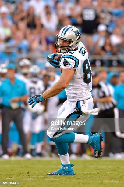 Greg Olsen of the Carolina Panthers makes a catch against the Houston Texans during their game at Bank of America Stadium on August 9 2017 in...