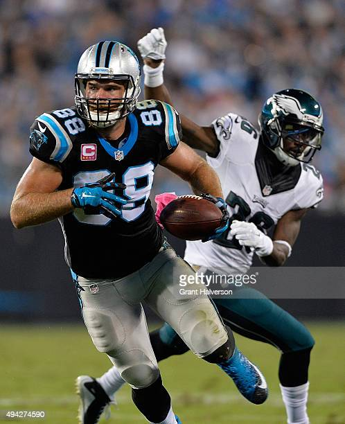 Greg Olsen of the Carolina Panthers makes a catch against Walter Thurmond of the Philadelphia Eagles during their game at Bank of America Stadium on...