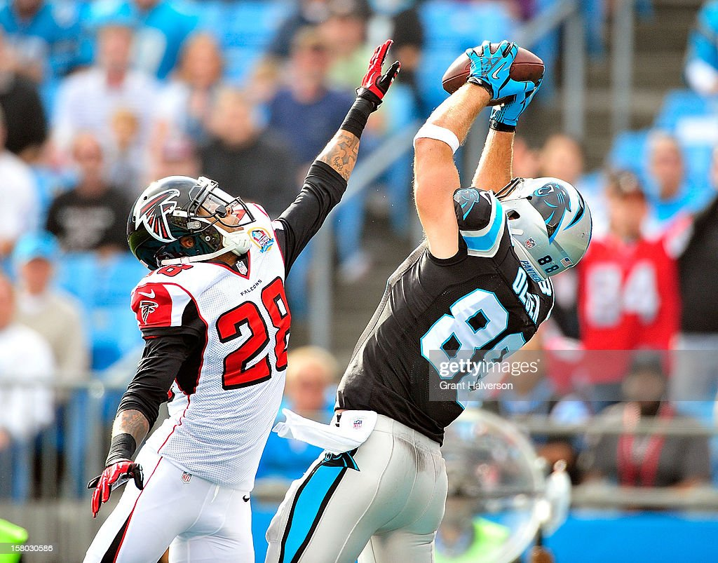Greg Olsen #88 of the Carolina Panthers makes a touchdown catch against Thomas DeCoud #28 of the Atlanta Falcons during play at Bank of America Stadium on December 9, 2012 in Charlotte, North Carolina.