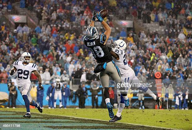 Greg Olsen of the Carolina Panthers makes a touchdown catch against Vontae Davis of the Indianapolis Colts in the 3rd quarter during their game at...