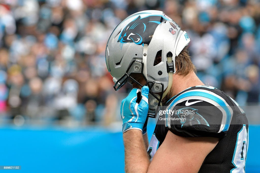 Greg Olsen #88 of the Carolina Panthers pauses before their game against the Tampa Bay Buccaneers at Bank of America Stadium on December 24, 2017 in Charlotte, North Carolina.