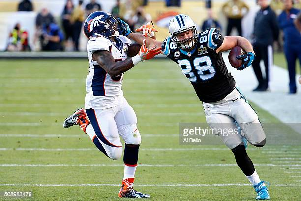 Greg Olsen of the Carolina Panthers runs after a catch against Danny Trevathan of the Denver Broncos in the first half during Super Bowl 50 at Levi's...