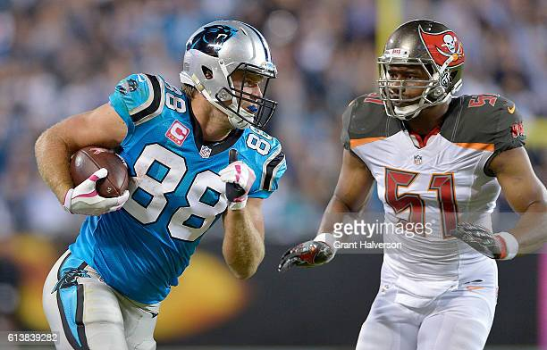 Greg Olsen of the Carolina Panthers runs the ball against Daryl Smith of the Tampa Bay Buccaneers in the 3rd quarter during the game at Bank of...