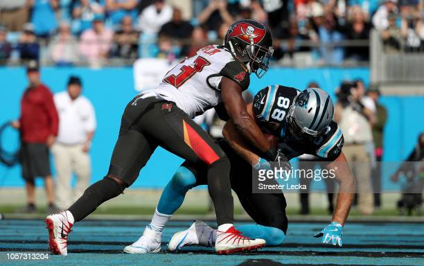 Greg Olsen of the Carolina Panthers scores a touchdown against Adarius Taylor of the Tampa Bay Buccaneers in the second quarter during their game at...