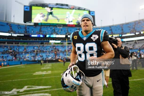 Greg Olsen of the Carolina Panthers walks off the field after their game against the New Orleans Saints at Bank of America Stadium on December 29,...