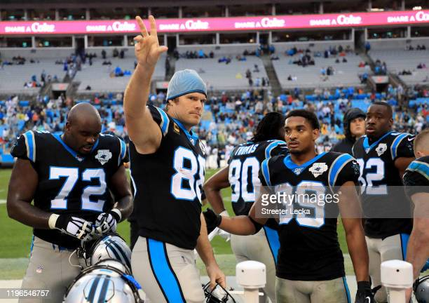 Greg Olsen of the Carolina Panthers waves to the crowd after being defeated by the New Orleans Saints 42-10 at Bank of America Stadium on December...