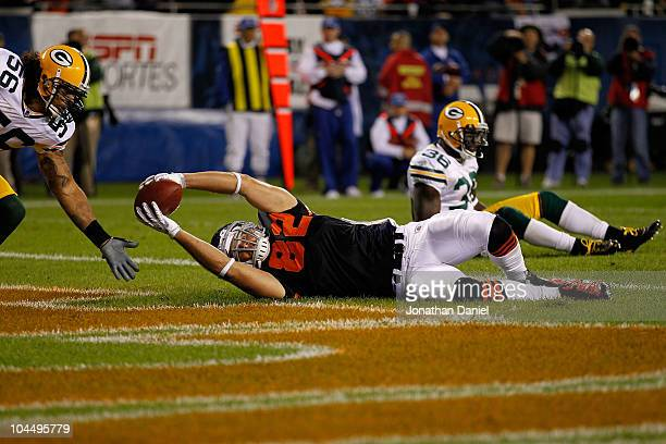 Greg Olsen of the Chicago Bears catches a 9yard touchdown reception in the second quarter against Nick Barnett and Nick Collins of the Green Bay...