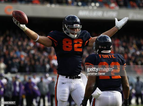 Greg Olsen of the Chicago Bears celebrates a touchdown catch with teammate Matt Forte against the Minnesota Vikings at Soldier Field on November 14...