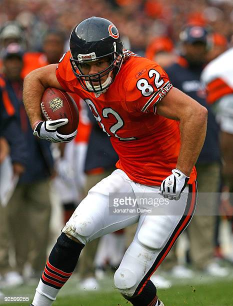 Greg Olsen of the Chicago Bears tries to avoid a Cleveland Brown tackler after catching a pass at Soldier Field on November 1 2009 in Chicago...