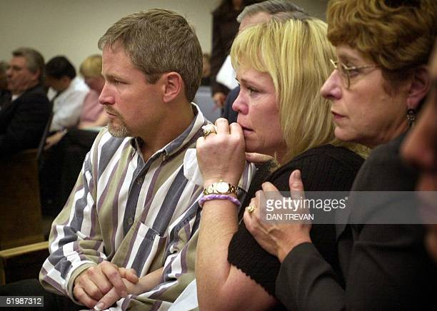 Greg Ostertag and Brenda Van Dam are shown during court as DA legal support Juliette Bolton comforts them during arraignment proceedings for David...