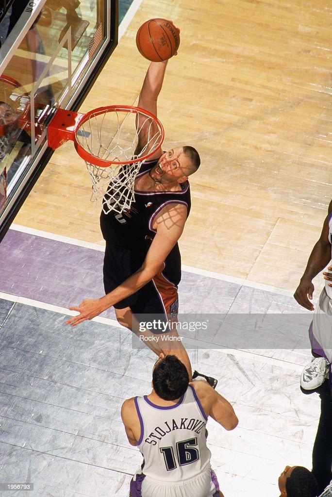 Greg Ostertag of the Utah Jazz dunks against the Sacramento Kings in ... 2224fb8da