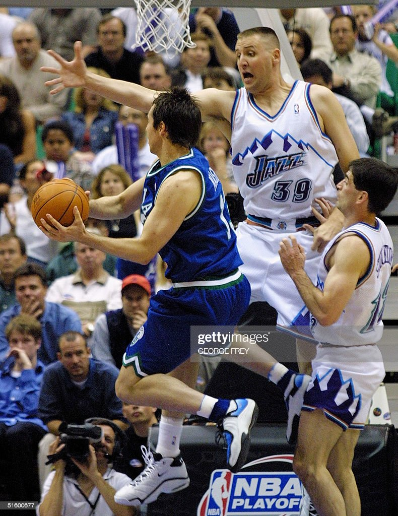 Greg Ostertag of the Utah Jazz tries to block the shot of Steve Nash ... e5db149f0