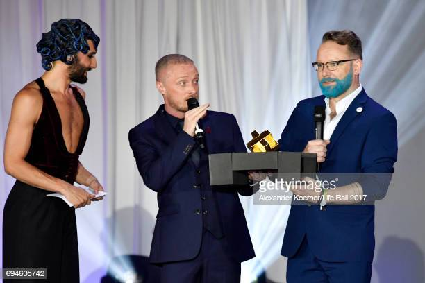 Greg Owen and Will Nutland accept their LIFE award during the Life Ball 2017 show at City Hall on June 10 2017 in Vienna Austria
