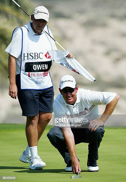 Greg Owen of England lines up a putt on the eighth hole during the second round of the 2004 Dubai Desert Classic played at the Emirates Golf Club on...