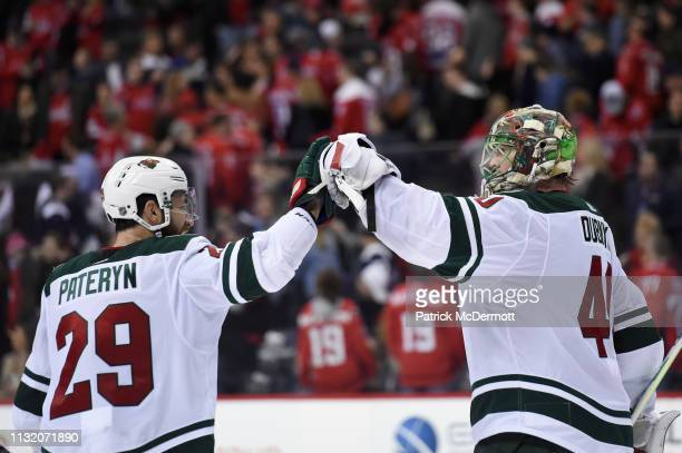 Greg Pateryn and Devan Dubnyk of the Minnesota Wild celebrate after the Wild defeated the Washington Capitals 21 at Capital One Arena on March 22...
