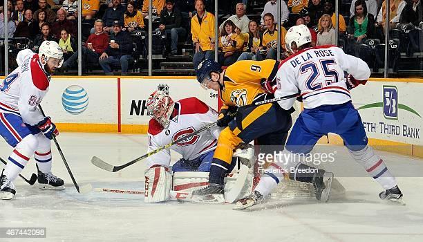 Greg Pateryn and Jacob De La Rose of the Montreal Canadiens defend Filip Forsberg of the Nashville Predators in front of Canadiens goalie Carey Price...