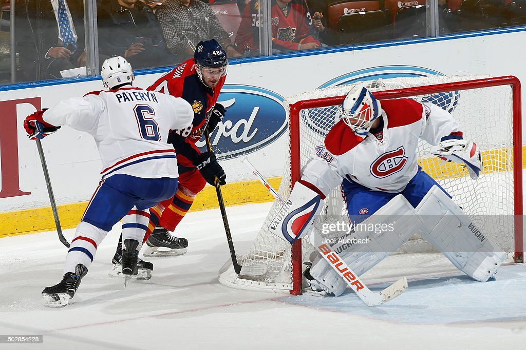 Greg Pateryn #6 assists goaltender Ben Scrivens #40 of the Montreal Canadiens defend the net against Logan Shaw #48 of the Florida Panthers during third period action at the BB&T Center on December 29, 2015 in Sunrise, Florida. The Panthers defeated the Canadiens 3-1.