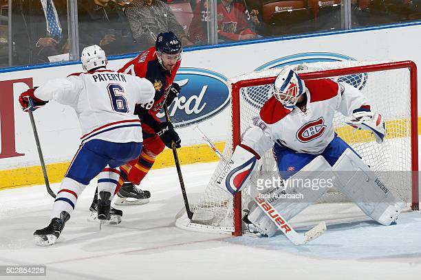 Greg Pateryn assists goaltender Ben Scrivens of the Montreal Canadiens defend the net against Logan Shaw of the Florida Panthers during third period...