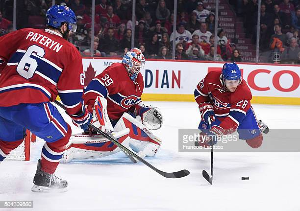 Greg Pateryn Mike Condon and Nathan Beaulieu of the Montreal Canadiens defend the goal against the Pittsburgh Penguins in the NHL game at the Bell...