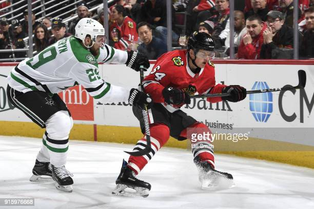 Greg Pateryn of the Dallas Stars pushes into David Kampf of the Chicago Blackhawks in the third period at the United Center on February 8 2018 in...