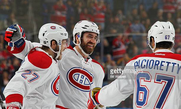 Greg Pateryn of the Montreal Canadiens celebrates his second period goal against the Buffalo Sabres with teammates Alex Galchenyuk Max Pacioretty...