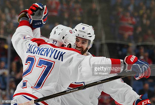 Greg Pateryn of the Montreal Canadiens celebrates his second period goal against the Buffalo Sabres with teammates Alex Galchenyuk during an NHL game...