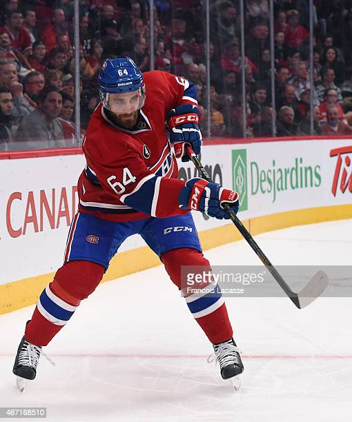 Greg Pateryn of the Montreal Canadiens clears the puck against the Carolina Hurricanes in the NHL game at the Bell Centre on March 19 2015 in...