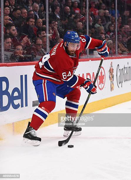 Greg Pateryn of the Montreal Canadiens controls the puck against the Detroit Red Wings in the NHL game at the Bell Centre on April 9 2015 in Montreal...