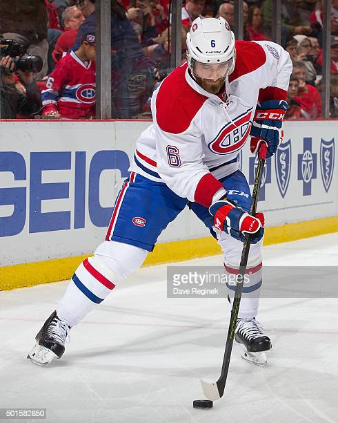 Greg Pateryn of the Montreal Canadiens controls the puck during an NHL game against the Detroit Red Wings at Joe Louis Arena on December 10 2015 in...