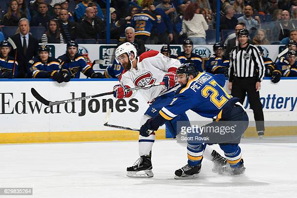 Greg Pateryn of the Montreal Canadiens shoots as Alex Pietrangelo of the St Louis Blues defends on December 6 2016 at Scottrade Center in St Louis...