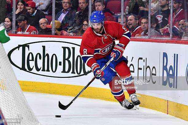 Greg Pateryn of the Montreal Canadiens skates the puck during the NHL game against the Tampa Bay Lightning at the Bell Centre on October 27 2016 in...