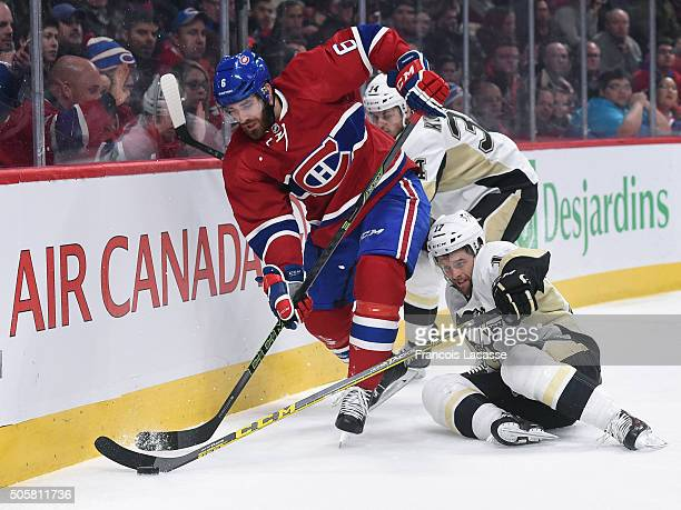 Greg Pateryn of the Montreal Canadiens tries to keep the puck from Bryan Rust and Tom Kuhnhackl of the Pittsburgh Penguins in the NHL game at the...
