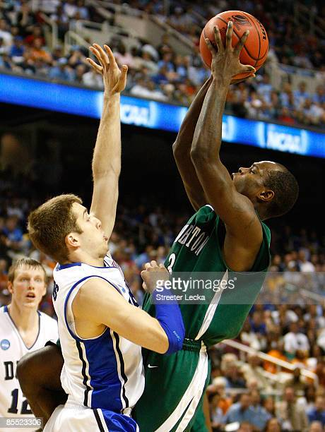 Greg Paulus of the Duke Blue Devils defends against Malik Alvin of the Binghamton Bearcats during the first round of the NCAA Division I Men's...