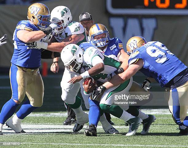 Greg Peach of the Winnipeg Blue Bombers sacks quarterback Darian Durant of the Saskatchewan Roughriders in first half action in a CFL game at...