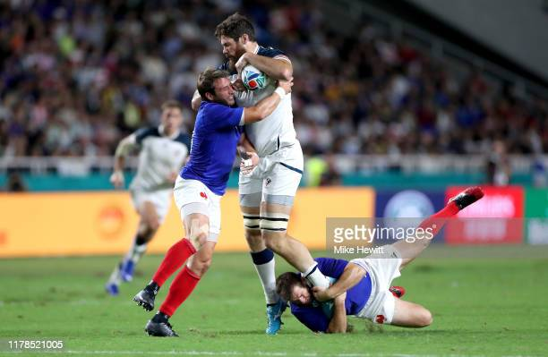 Greg Peterson of the United States is tackled by Camille Lopez and Sebastien Vahaamahina of France during the Rugby World Cup 2019 Group C game...