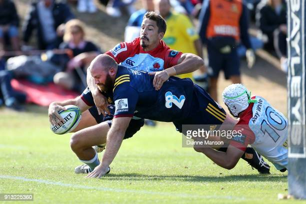 Greg PleasantsTate of the Highlanders dives over to score a try during the Super Rugby preseason match between the Highlanders and the Waratahs on...
