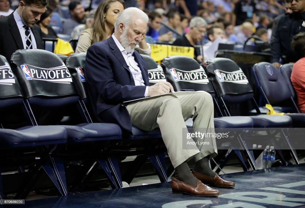 Greg Popovich the head coach of the San Antonio Spurs draws up a play while on the bench against the Memphis Grizzlies in game three of the Western Conference Quarterfinals during the 2017 NBA Playoffs at FedExForum on April 20, 2017 in Memphis, Tennessee.