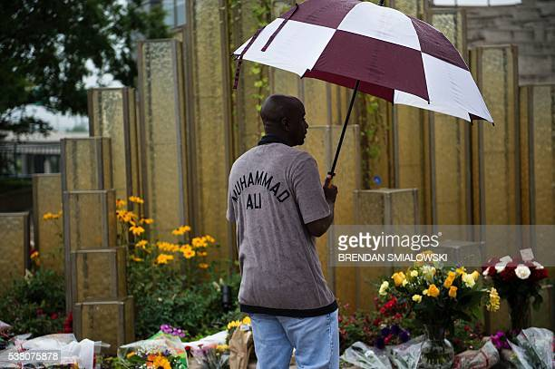 Greg Posley pays his respects at a makeshift memorial for boxing legend Muhammad Ali at the Muhammad Ali Center on June 4 2016 in Louisville Kentucky...