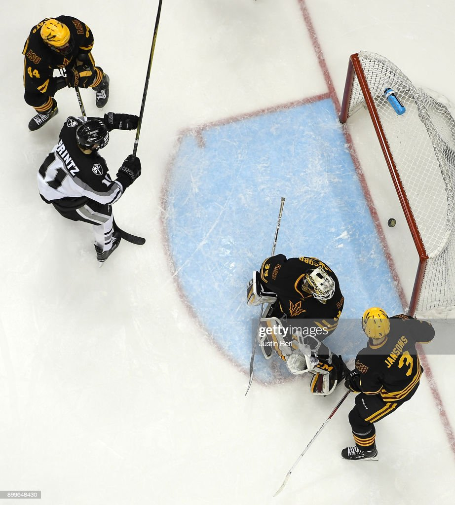 Greg Printz #11 of the Providence Friars reacts after scoring a goal past Joey Daccord #35 of the Arizona State Sun Devils in the third period during the game at PPG PAINTS Arena on December 29, 2017 in Pittsburgh, Pennsylvania.