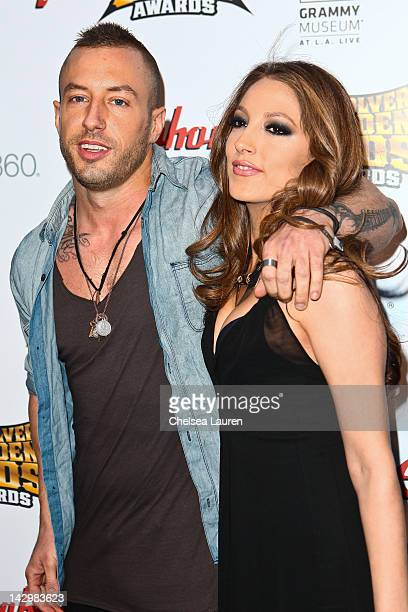 Greg Puciato of The Dillinger Escape Plan and adult film star Jenna Haze arrive at the 4th annual Revolver Golden Gods awards at Club Nokia on April...