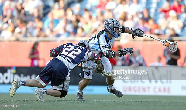 Greg Puskuldjian of Ohio Machine runs the ball by Craig Bunker of Boston Cannons in the second half at Gillette Stadium on July 11 2015 in Foxboro...