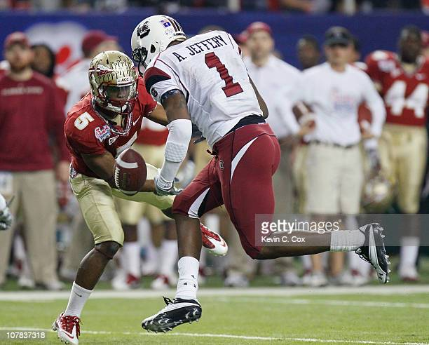 Greg Reid of the Florida State Seminoles breaks up a pass intended for Alshon Jeffery of the South Carolina Gamecocks during the 2010 ChickfilA Bowl...