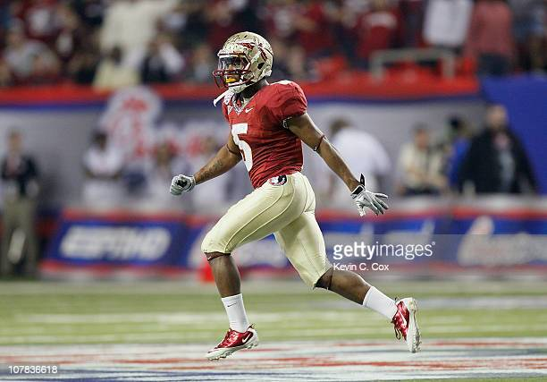 Greg Reid of the Florida State Seminoles reacts after returning an interception against the South Carolina Gamecocks during the 2010 ChickfilA Bowl...