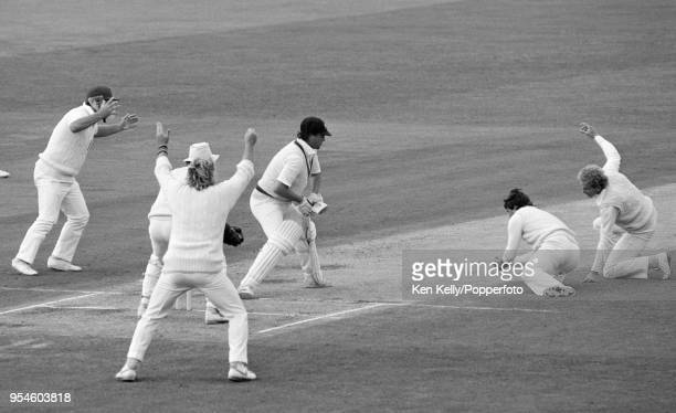 Greg Ritchie of Australia is caught for 20 runs by England fielder Allan Lamb off the bowling of John Emburey during the 5th Test match between...