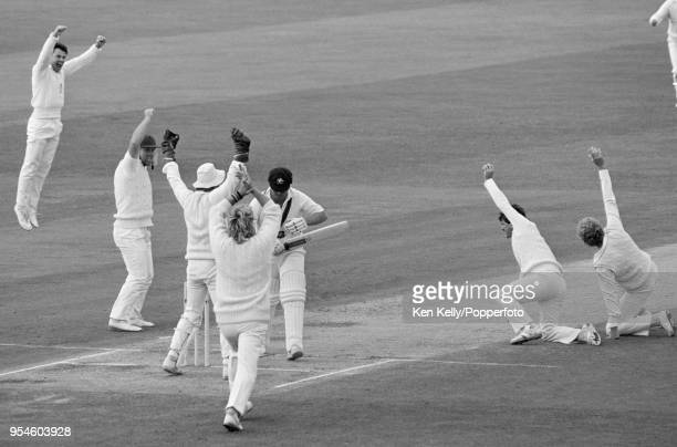 Greg Ritchie of Australia walks off after being caught for 20 runs by England fielder Allan Lamb off the bowling of John Emburey during the 5th Test...