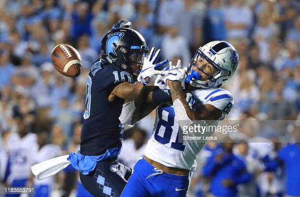 Greg Ross of the North Carolina Tar Heels breaks up a pass intended for Aaron Young of the Duke Blue Devils during their game at Kenan Stadium on...
