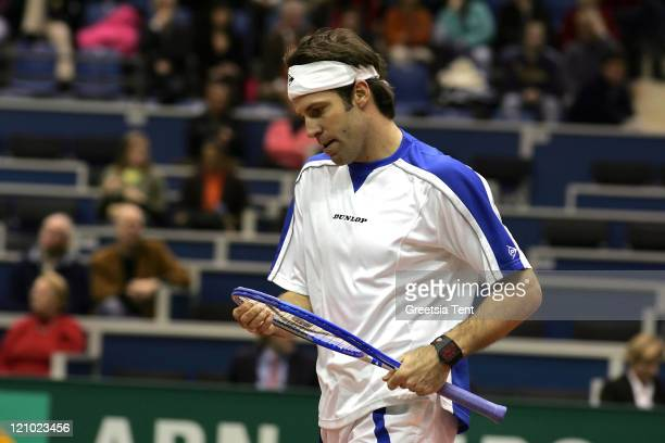 Greg Rusedski in action against Nikolay Davydenko during their second round match during the ABN AMRO World Tennis Tournament at the Ahoy' in...