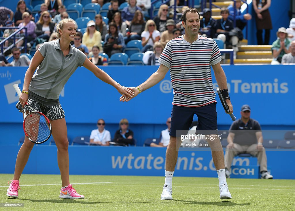 Greg Rusedski of Great Britain and Petra Kvitova of the Czech Republic celebrates a point during the Rally for Bally mixed doubles charity match on day two of the Aegon International at Devonshire Park on June 15, 2014 in Eastbourne, England.