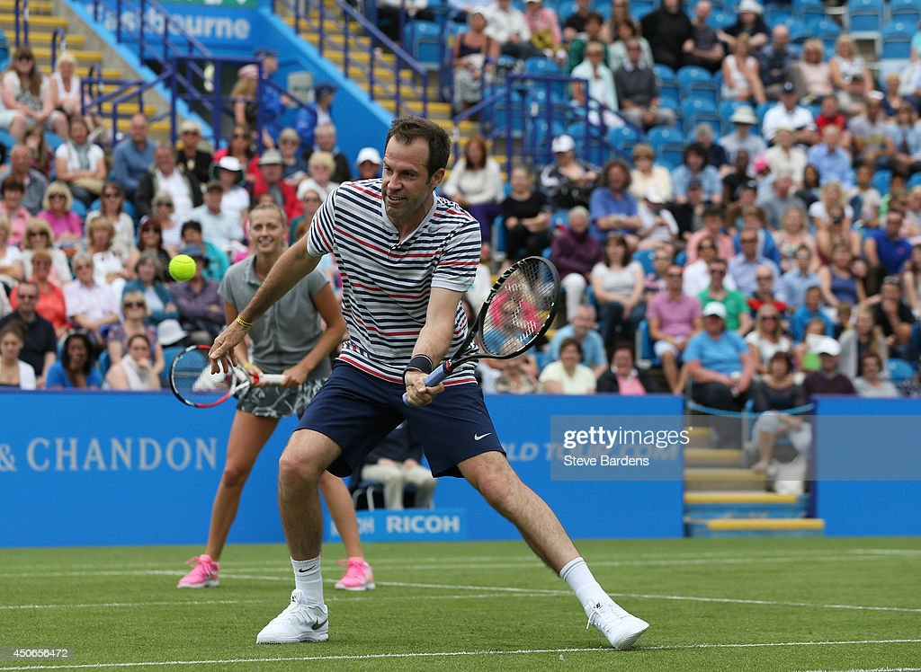 Greg Rusedski of Great Britain and Petra Kvitova of the Czech Republic in action during the Rally for Bally mixed doubles charity match on day two of the Aegon International at Devonshire Park on June 15, 2014 in Eastbourne, England.